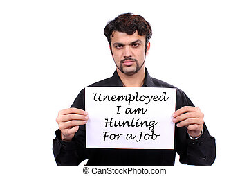 An unemployed Indian man holding a 'Looking for Job' banner, on white studio background.