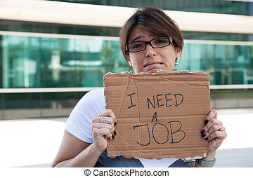 Unemployed woman - unemployed woman showing a message in a...