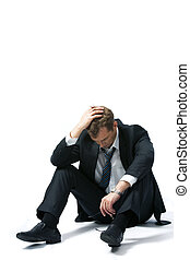 Unemployment - Portrait of stressed businessman touching his...