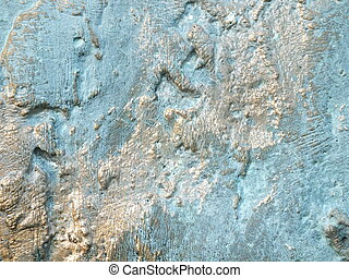 Uneven bronze surface with patina side-lit - to be used as background
