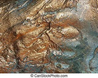 Uneven bronze surface with patina