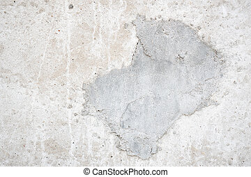 Uneven gray plaster covering the wall.