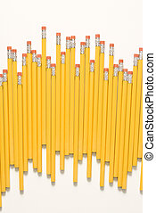 Uneven row of pencils.