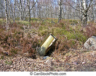 Unexploded rocket buried in the birch forest