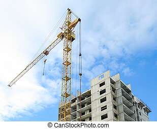Unfinished building and crane tower during sunrise - Photo: ...