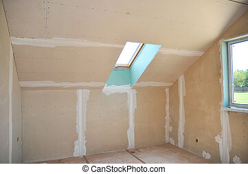 Unfinished House Attic Construction with Drywall and Skylight Window Interior.