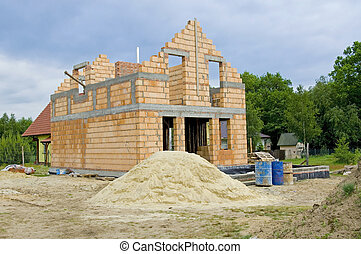 Unfinished house - Unfinished, one family house made of...