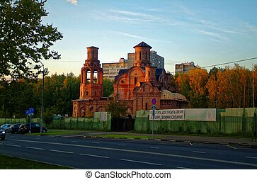 unfinished Orthodox Church in autumn against the forest