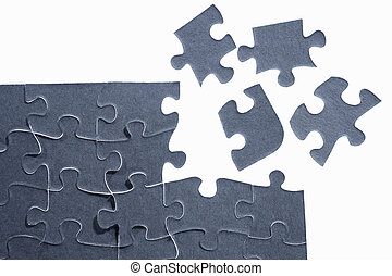 Unfinished puzzle at the corner with four segmented pieces...