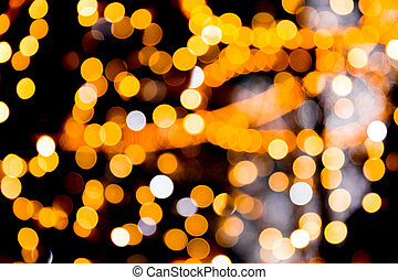 Unfocused abstract gold bokeh on black background. defocused and blurred many round light