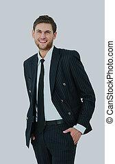 ung, affärsman, stående, med, hans, räcker, in, den, pockets.