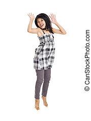 ung, asiatisk kvinna, hoppa för glädje