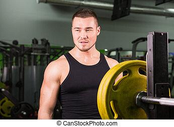 ung, hälsosam, man, med, stora musker, holdingen, skiva, vikter, in, gym., fitness, sport, utbildning, motivering, och, livsstil, begrepp