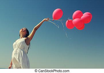 ung, innehållsrik kvinna, holdingen, röd, balloons., foto,...