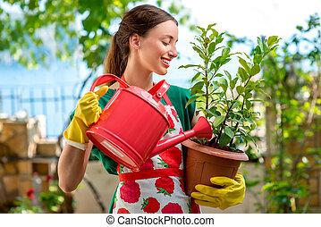 ung kvinna, arbete, i trädgården