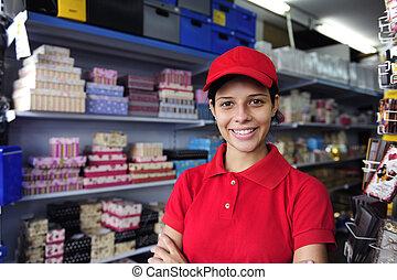 ung kvinna, arbete, in, a, gåvan boxas, lager
