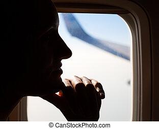 ung kvinna, flygning, in, airplane