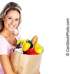 ung kvinna, med, a, speceri handling, bag.