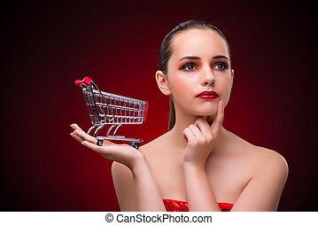 ung kvinna, med, shoppa vagnen