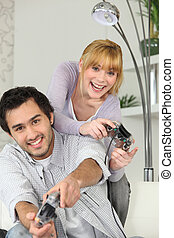 ung kvinna, och, ung man, spelande video vilt
