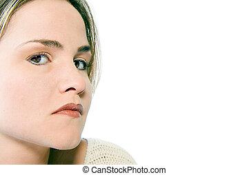 ung kvinna, titta i sidled