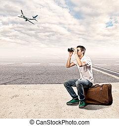 ung man, användande, kikare, hos, den, flygplats