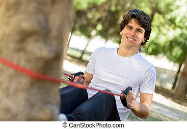 ung man, exercerande, med, sträckning musikkår