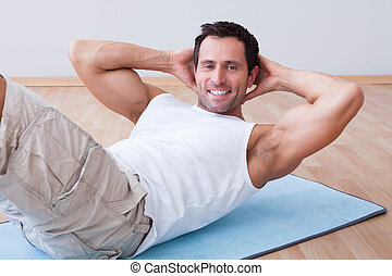 ung man, exercerande, på, övning matta