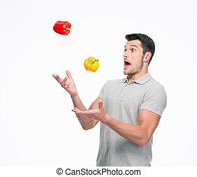 ung man, jonglera, peppar