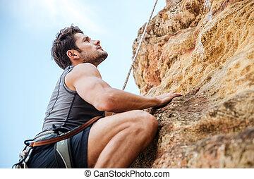 ung man, klättrande, a, brant, vägg, in, fjäll