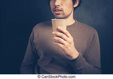 ung man, med, en tidning, kopp