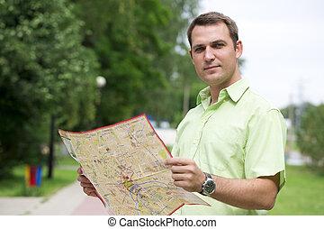 ung, manlig, turist, med, karta, in, hand, bra, looking.