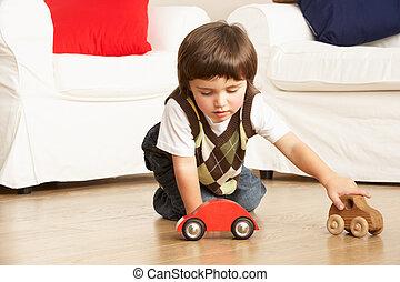 ung pojke, leka, med, leksak bilar, hemma