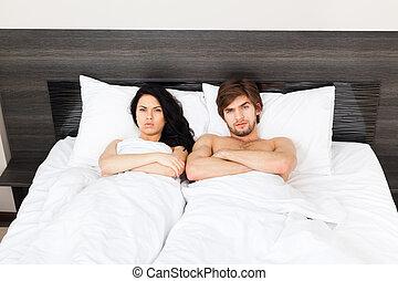 ungt par, säng