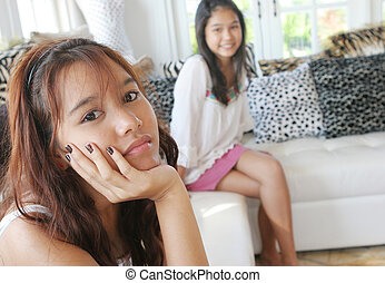 Unhappy Asian teenager