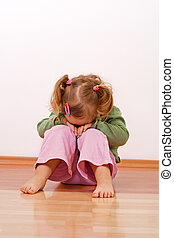 Unhappy baby girl - Little girl laying laying had on her...
