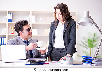 Unhappy boss having a chat with his secretary