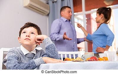 Unhappy boy with quarreling parents