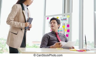 Unhappy business people dispute work problem at office . ...