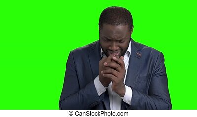 Unhappy businessman is crying on green screen. Depressed...