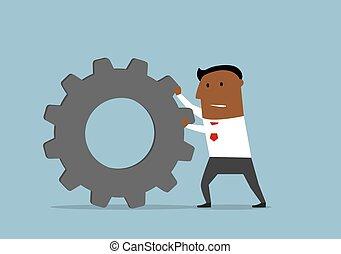 Unhappy businessman pushing a gear wheel