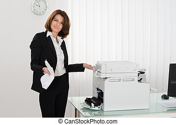 Unhappy Businesswoman Holding Crumpled Paper