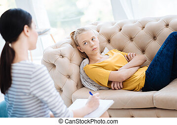 Unhappy cheerless woman looking at her therapist