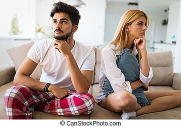 Unhappy couple having crisis and difficulties in relationship