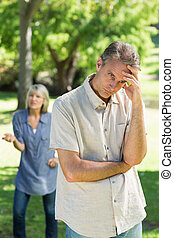 unhappy couple in park