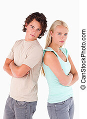Unhappy couple looking into the camera