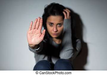unhappy crying woman showing defensive gesture