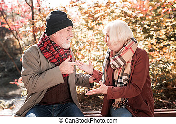 Unhappy elderly couple talking about their problems