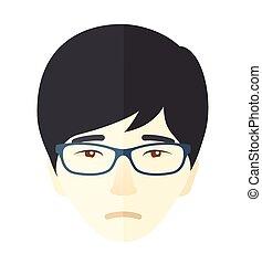 Unhappy face of young boy.