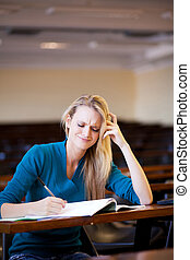 unhappy female college student studying